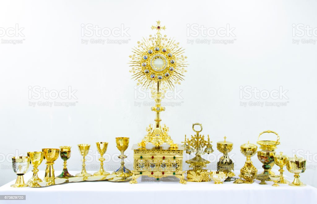 Golden holy religious equipment on white background stock photo