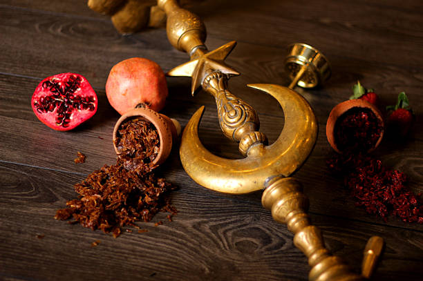 Golden hookah and pomegranate stock photo