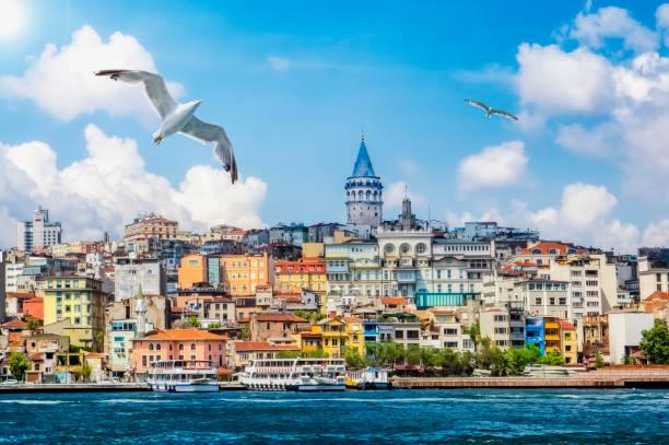 golden horn against galata tower, istanbul, turkey - каракёй стамбул стоковые фото и изображения
