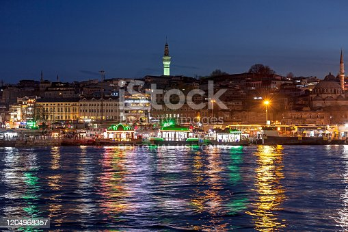 Istanbul / Turkey - 04.04.2015: Golden Horn at night and Historic Fire Tower (Seraskier Tower), Eminonu - Istanbul