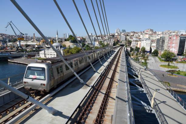golden horn metro bridge - wiedenmeier istanbul stock-fotos und bilder