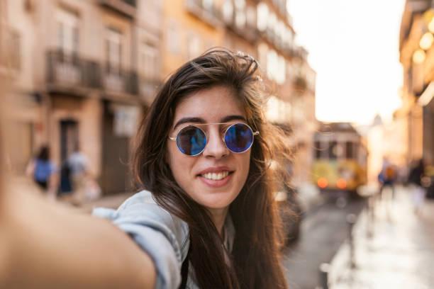 golden hour selfie in lisbon streets - eletrico lisboa imagens e fotografias de stock