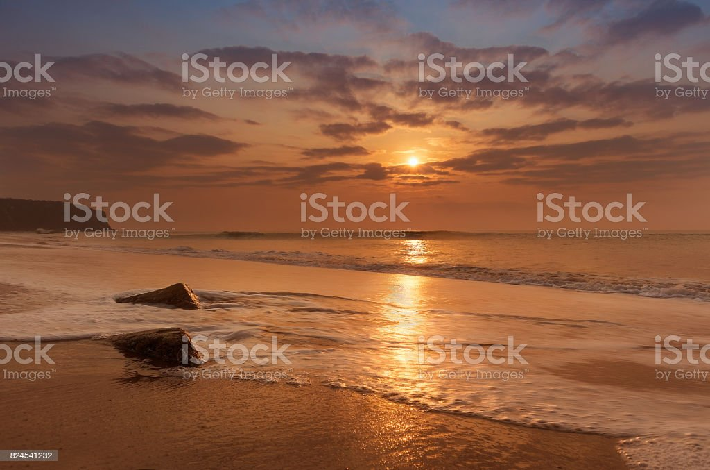 Golden hour sunset at cabo ledo beach, angola stock photo