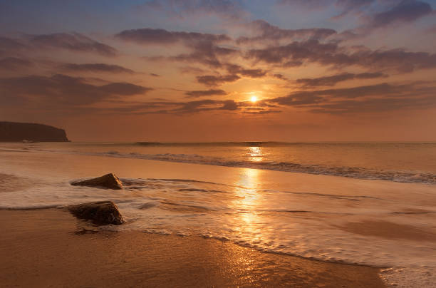 golden hour sunset at cabo ledo beach, angola - angola stock photos and pictures