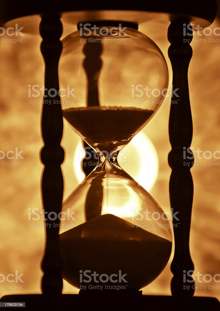 golden hourglass with sun royalty-free stock photo