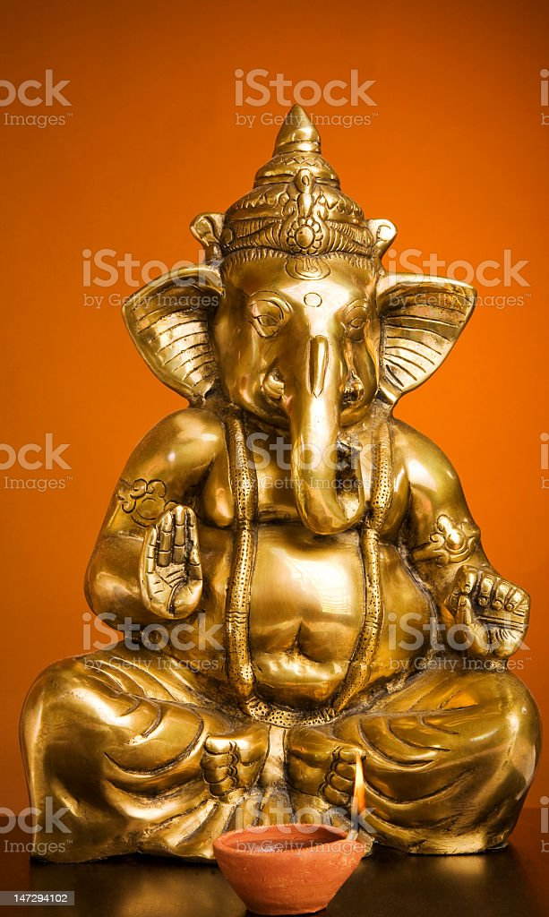 Golden Idol of Lord Ganesh Blessing Everyone stock photo