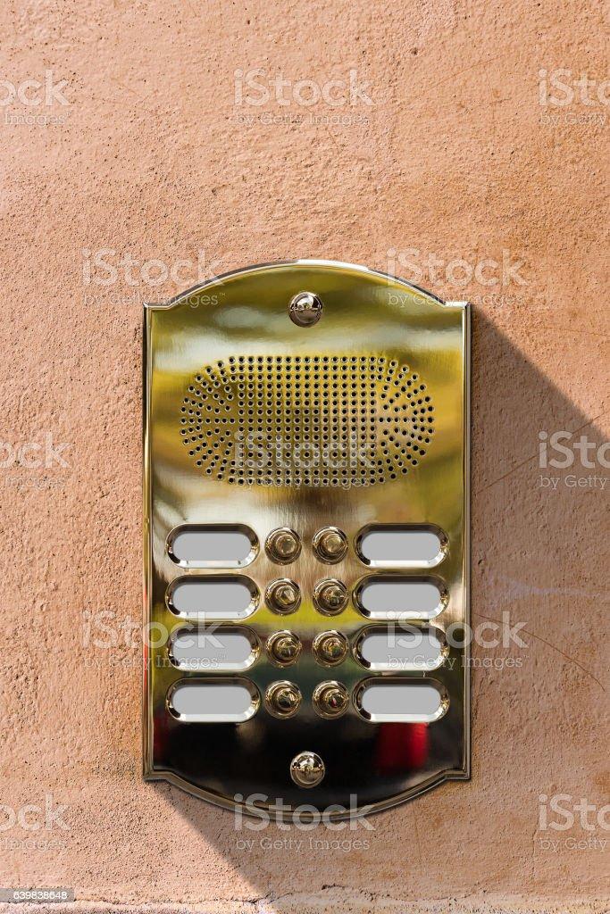 Golden Intercom on a Wall stock photo
