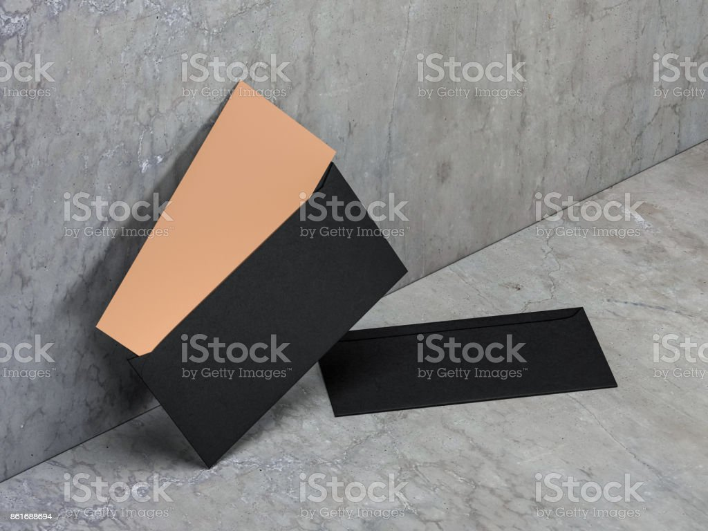 Golden invitation in black envelope on concrete floor, 3d rendering stock photo