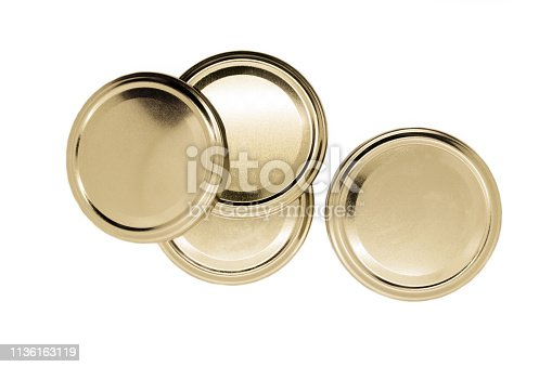 Golden jar lids isolated on white background