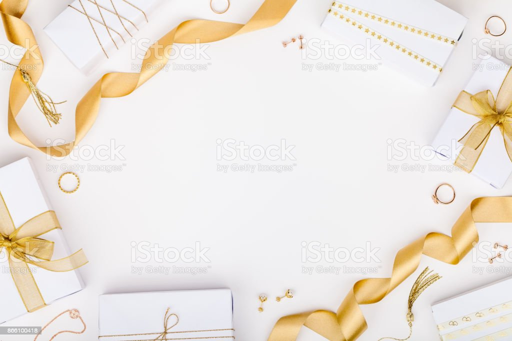 golden jewelry and gift boxes on white background with copy space for text. fashion and shopping concept. wedding, marriage or birthday composition. flat lay, top view stock photo