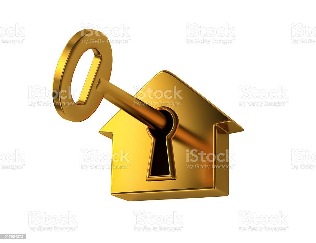 Golden key in keyhole stock photo