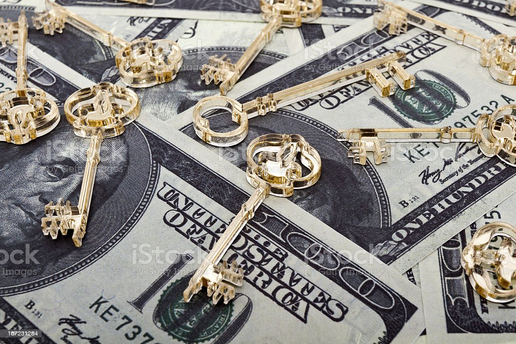 Golden keys on dollars royalty-free stock photo