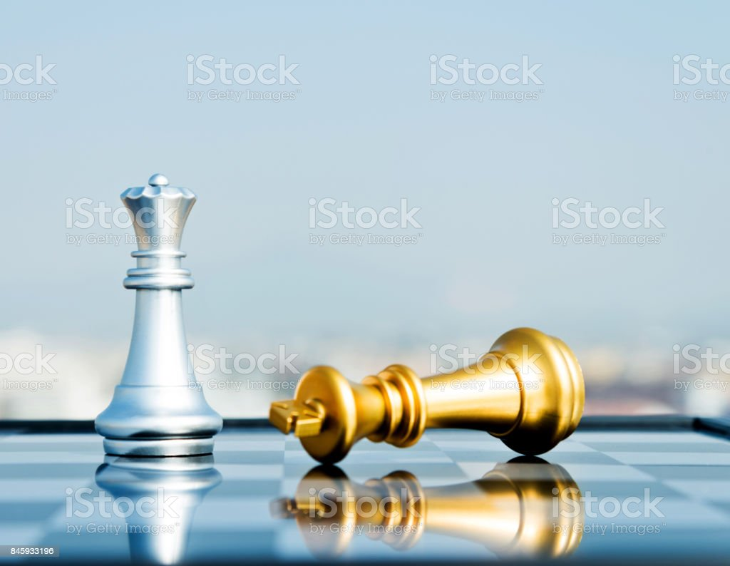 Golden king lying and silver queen standing stock photo