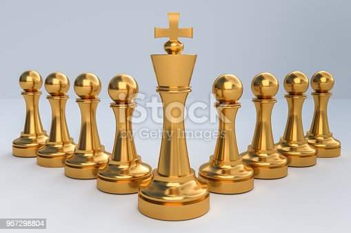 istock Golden King with golden pawns - chess teamwork concept 957298804