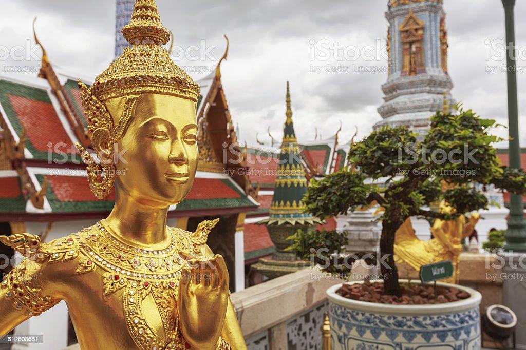 Golden Kinnari statue at Temple stock photo