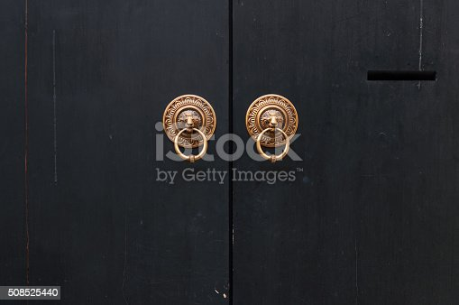 Each of the door knockers has a lion in the middle of it, holding the knocker ring in its mouth. The lions are believed to be one of Chinese dragon's sons, and are good guardians of homes and properties.