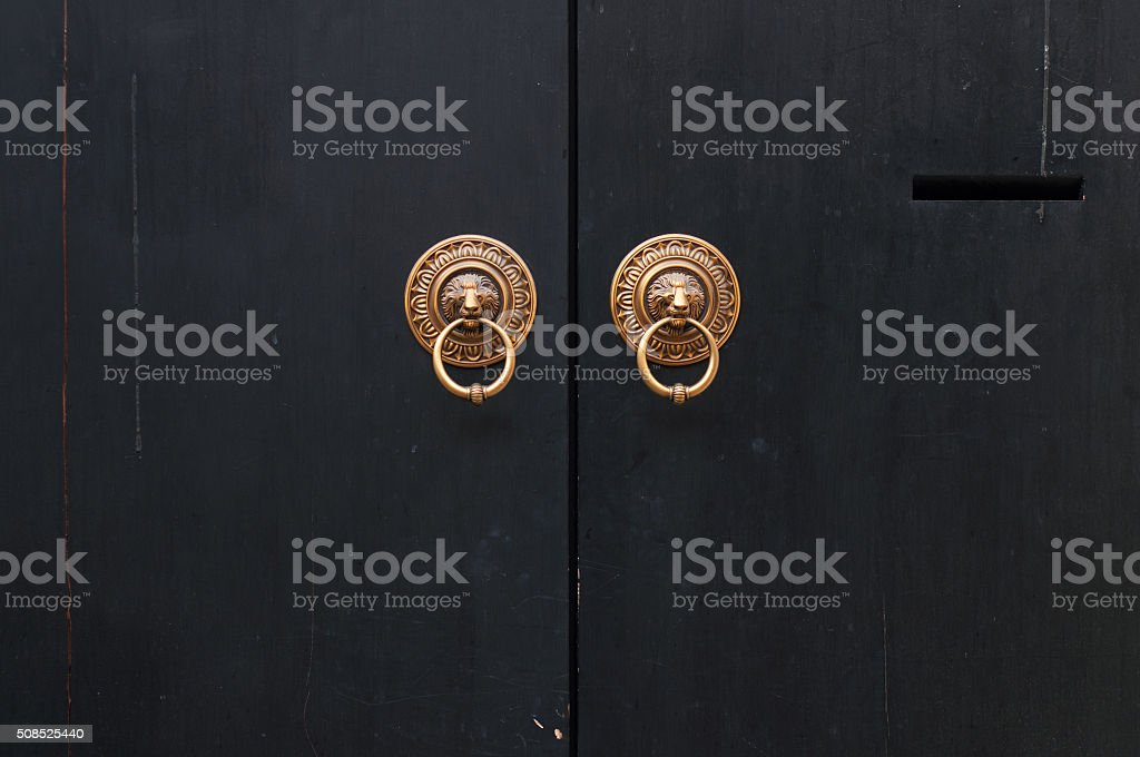 Golden Knockers on Traditional Chinese Gate stock photo