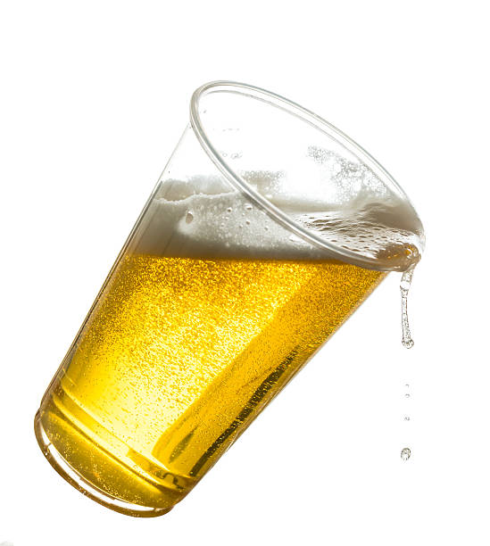Golden lager or beer in disposable plastic cup stock photo