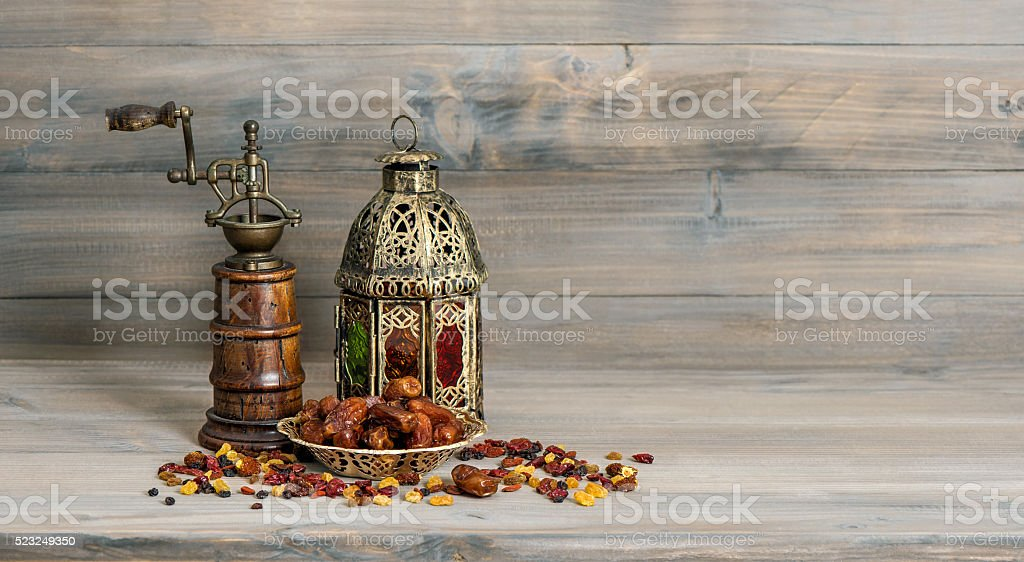 Golden lantern vintage mill. Oriental arabic decoration fruits stock photo