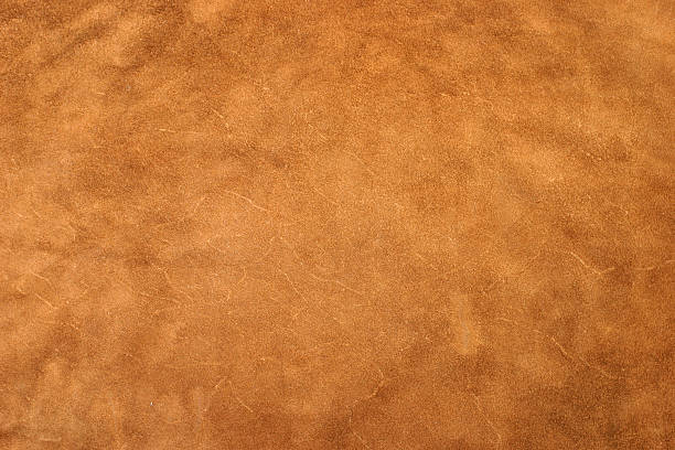 Golden Leather A detailed image of a large piece of leather. cowhide stock pictures, royalty-free photos & images