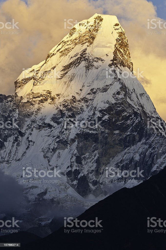 Golden light dramatic snow mountain summit Ama Dablam Himalayas Nepal stock photo