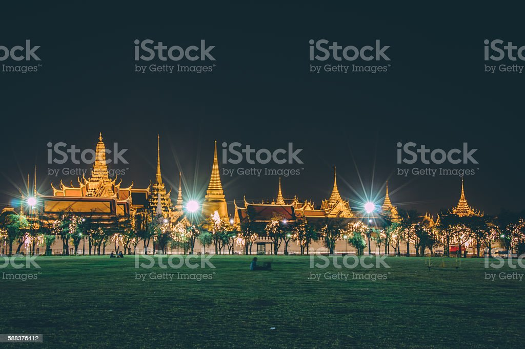 Golden light of Wat Phra Kaew from Sanam Luang stock photo