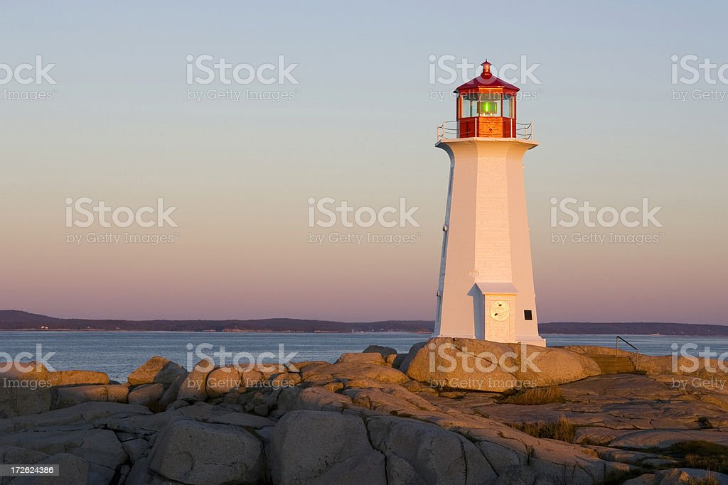 Golden light on Peggy's Cove lighthouse royalty-free stock photo