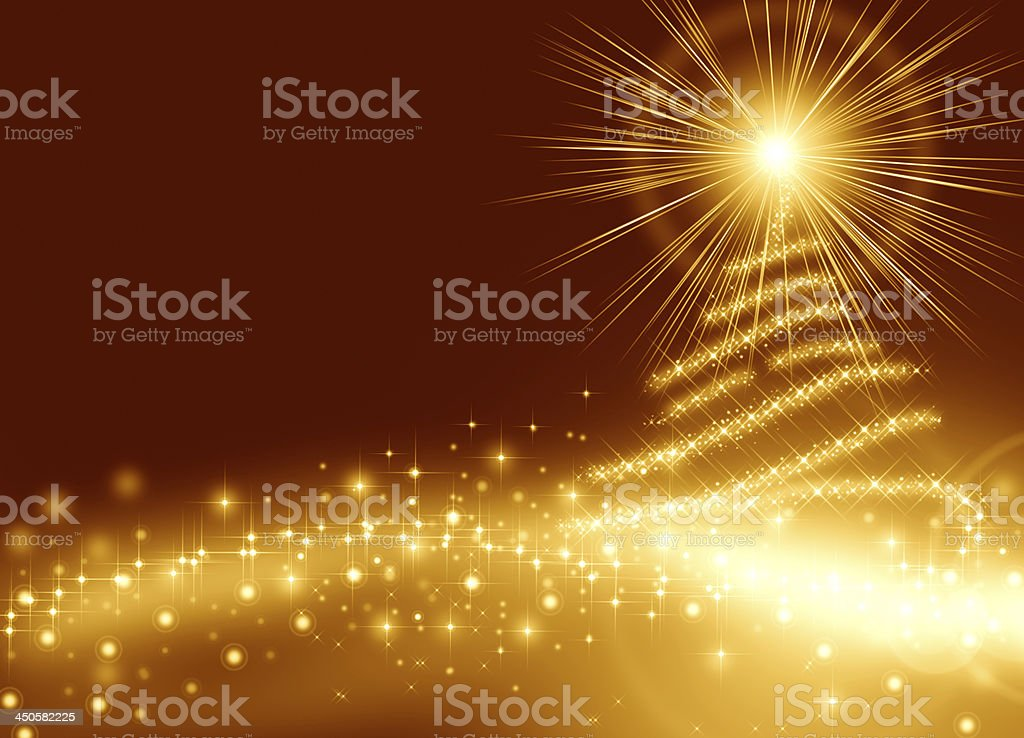 Golden lights and sparkles in the shape of a Christmas tree royalty-free stock photo