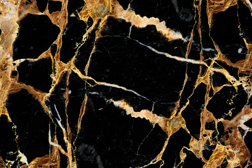 golden line on black of marbling pattern background