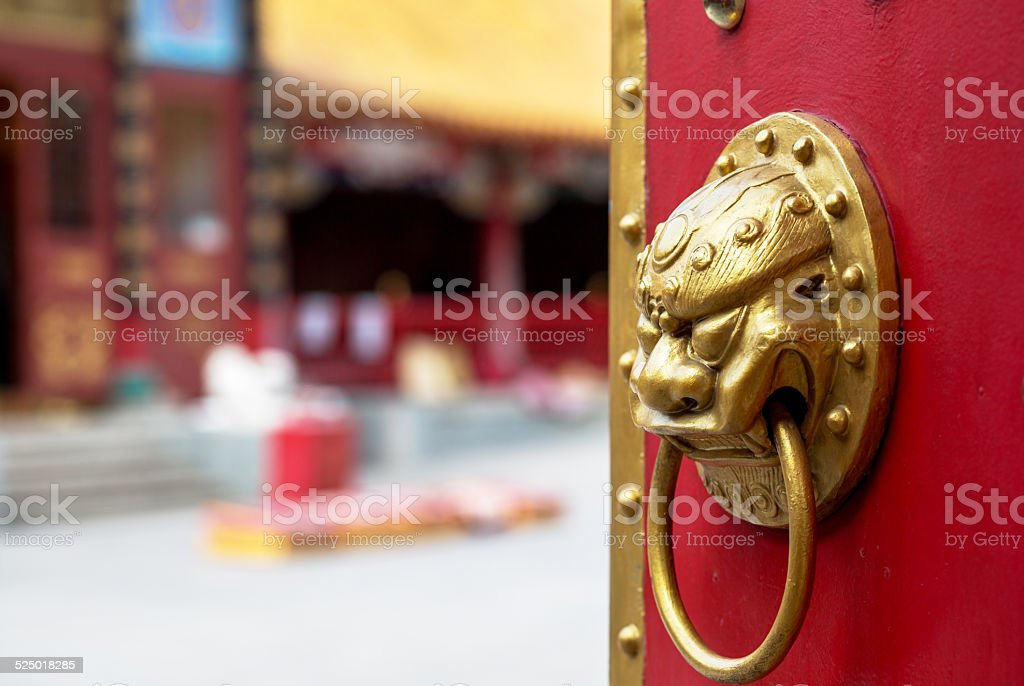 golden lion door knocker stock photo