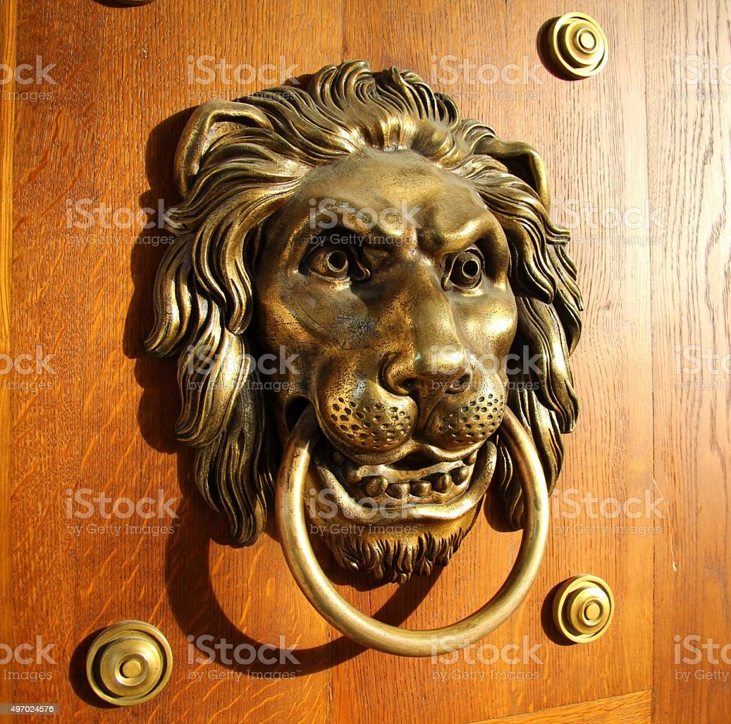 Golden Lion Doorhandle - side stock photo