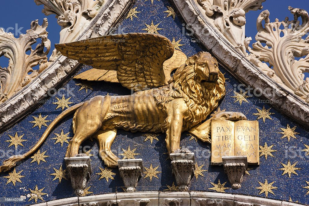 Golden Lion of St Mark in the city Venice stock photo