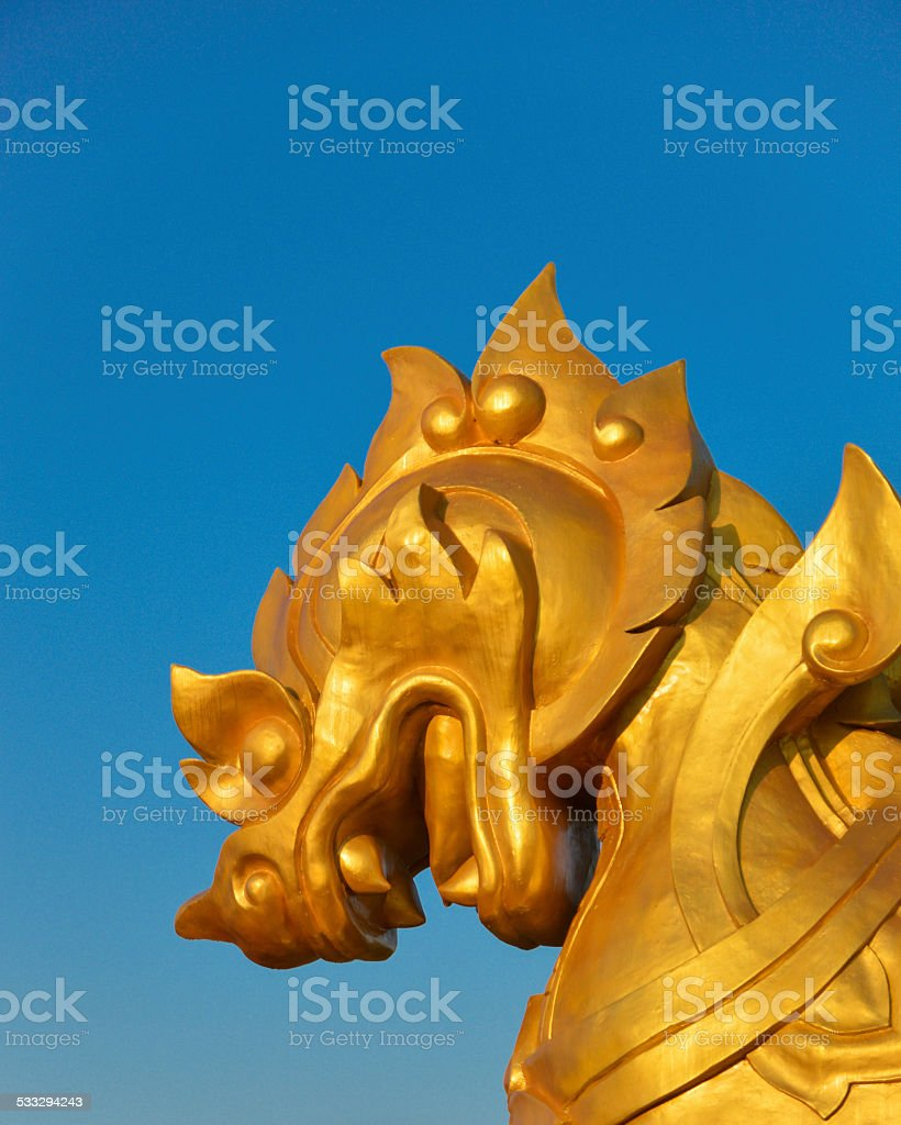 Golden Lion with Blue Sky stock photo