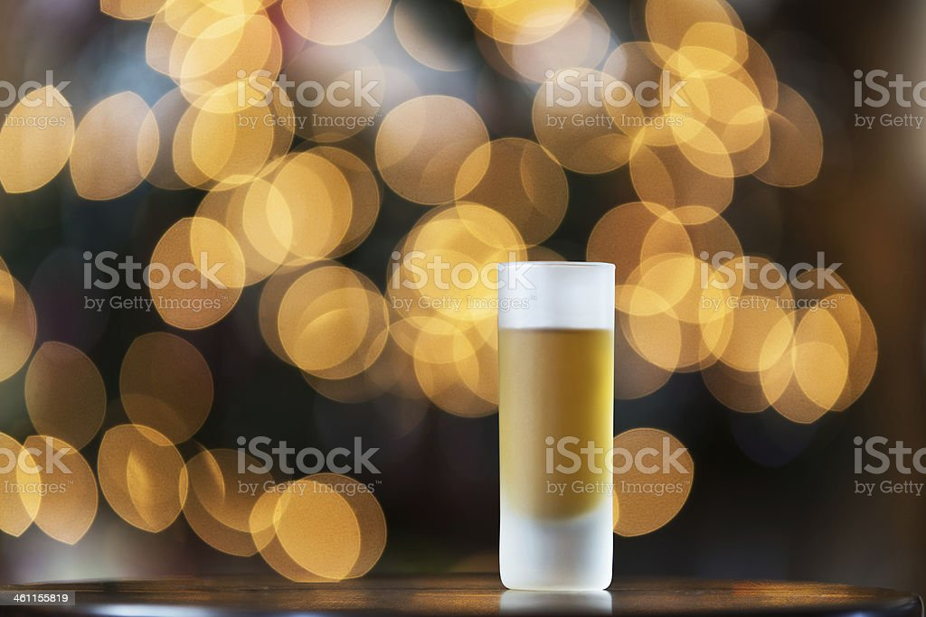 Golden Liqueur and Lights stock photo
