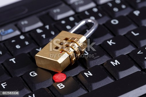 istock golden lock on black keyboard - computer security concept 652583006