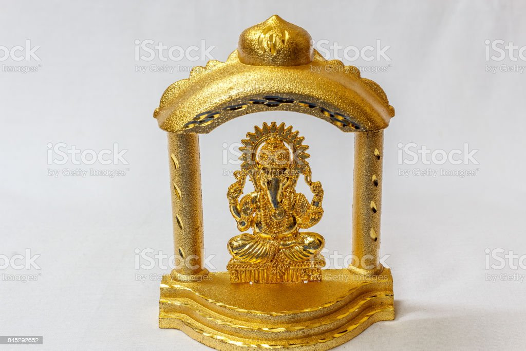 Golden Lord Ganesha Idol Designed In A Stage In A White Backdrop