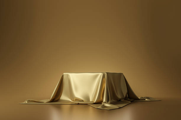 Golden luxurious fabric placed on top pedestal or blank podium shelf on gold background with luxury concept. 3D rendering. stock photo