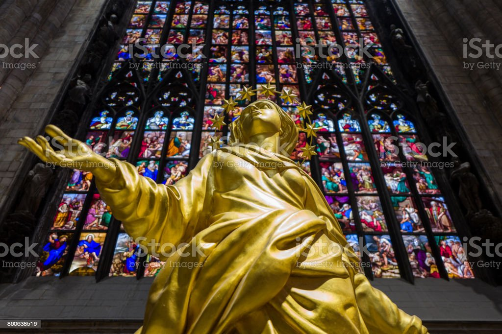 Golden madonnina statue inside Milan Cathedral stock photo