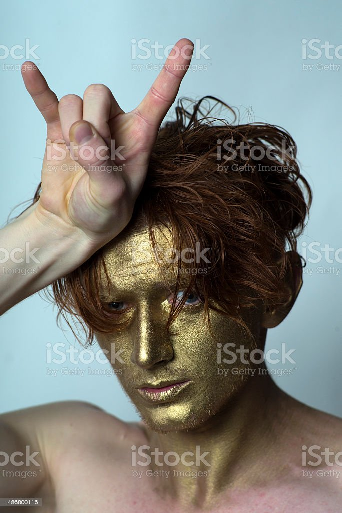Golden man with cool gesture stock photo