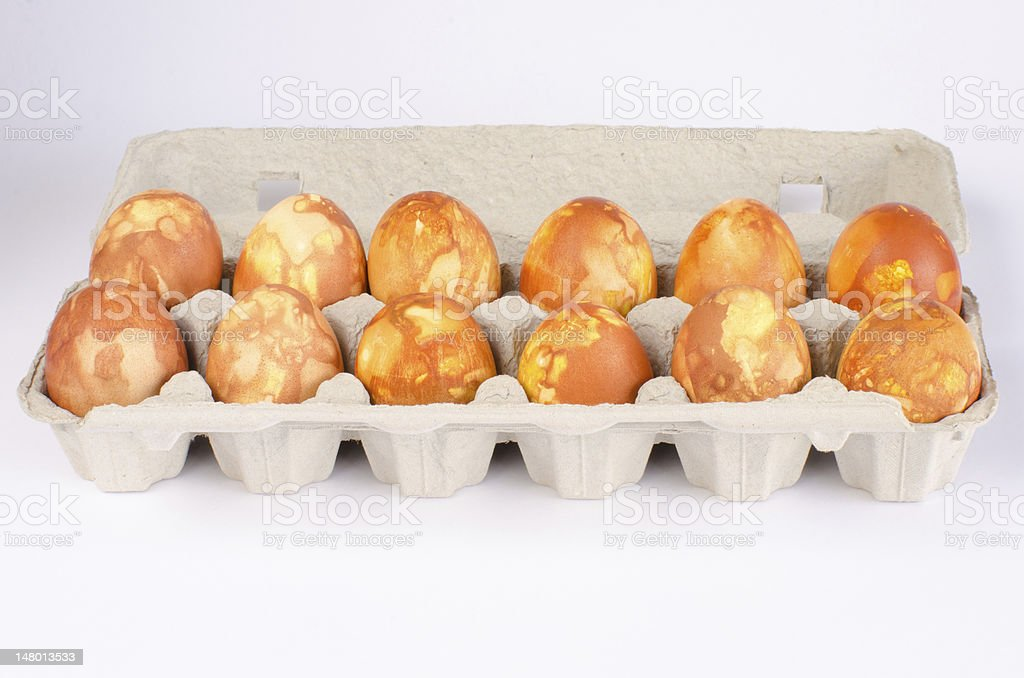 Golden marbled eggs in carton royalty-free stock photo