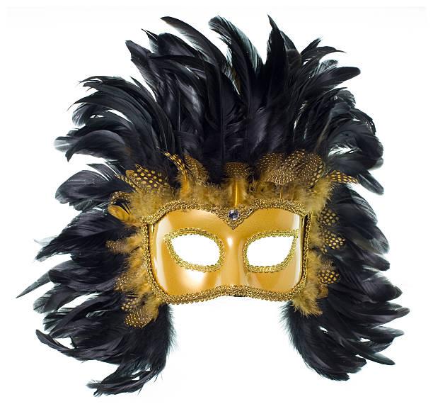 Golden Mardi Gras feather mask isolated on white stock photo