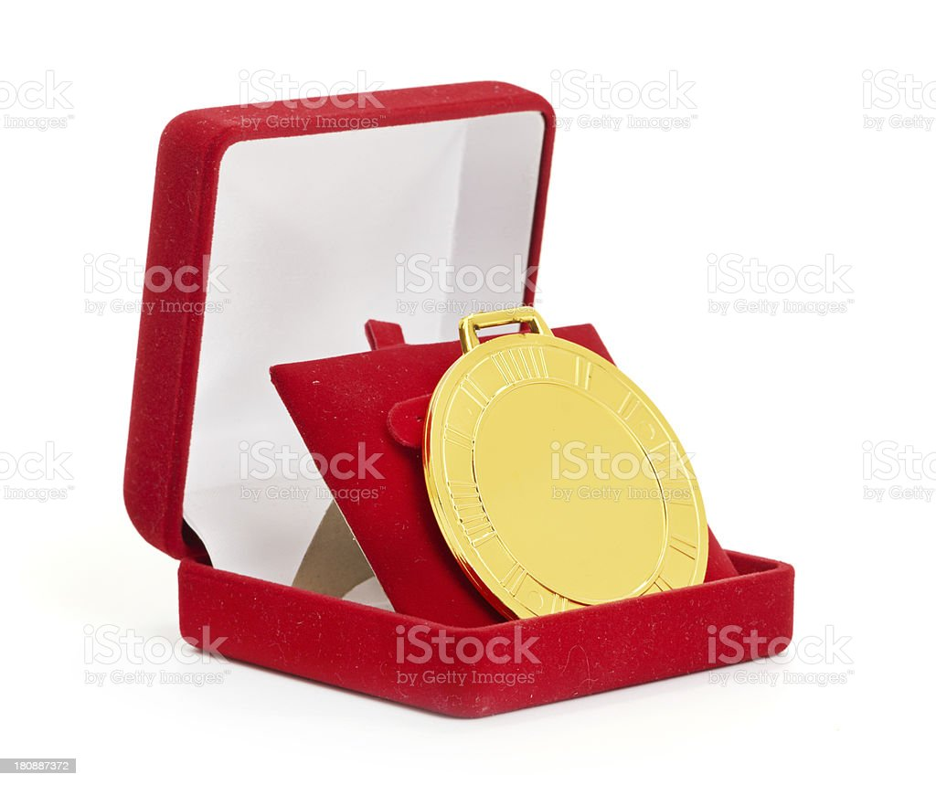 Golden medal in red gift box. royalty-free stock photo