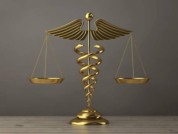 golden medical caduceus symbol as scales. 3d rendering - caduceus stock pictures, royalty-free photos & images