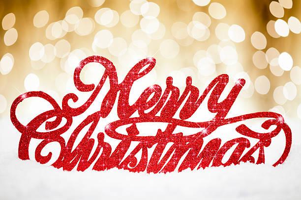 golden frohe weihnachten karte - es schneit text stock-fotos und bilder