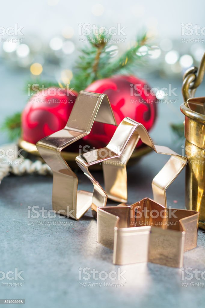 Golden metal cutting forms for christmas star cookies, biscuits, brass or copper stock photo