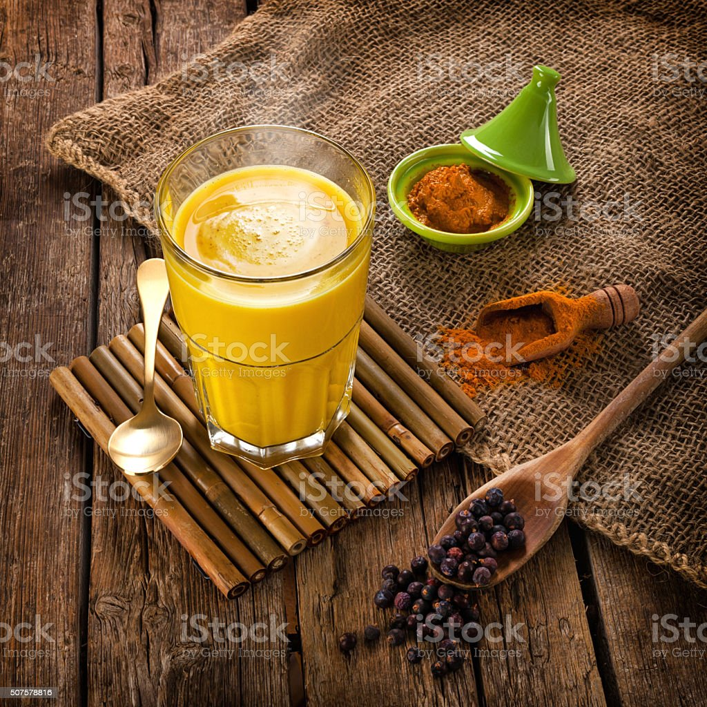 Golden Milk made with turmeric. stock photo