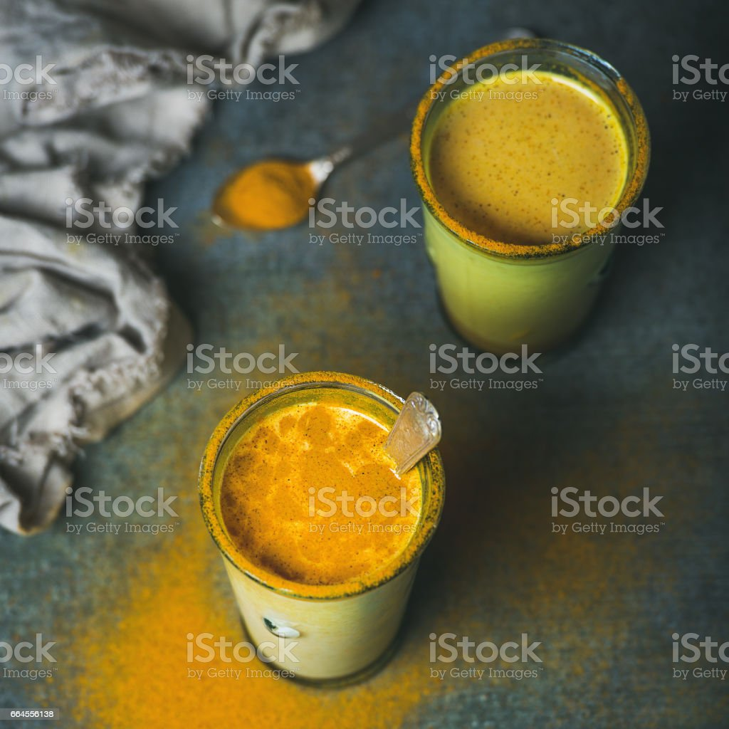 Golden milk with turmeric powder, dieting and weight loss concept stock photo