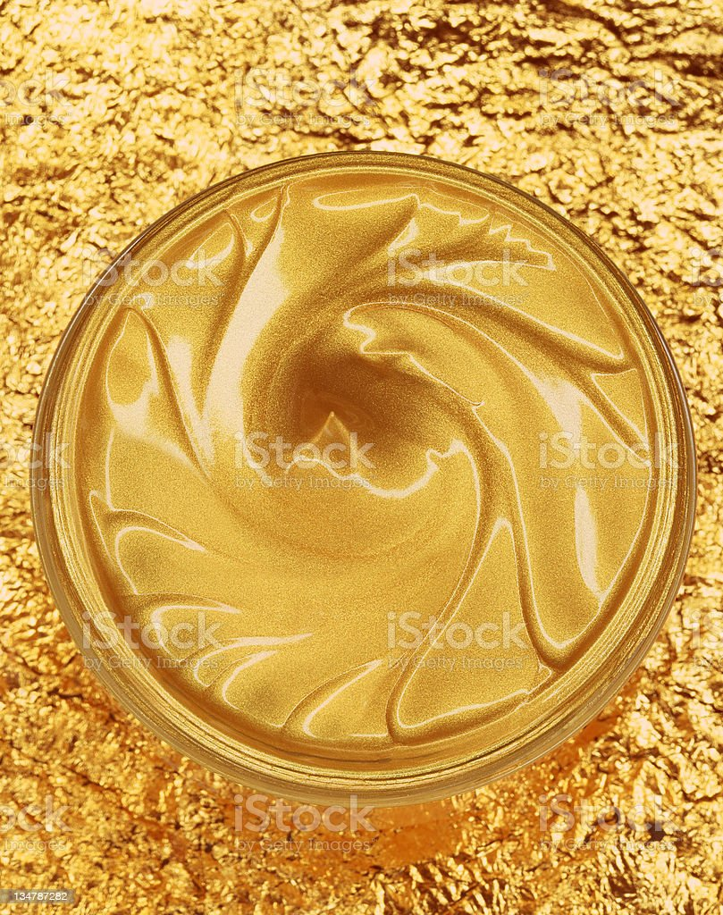 Golden moisturiser royalty-free stock photo
