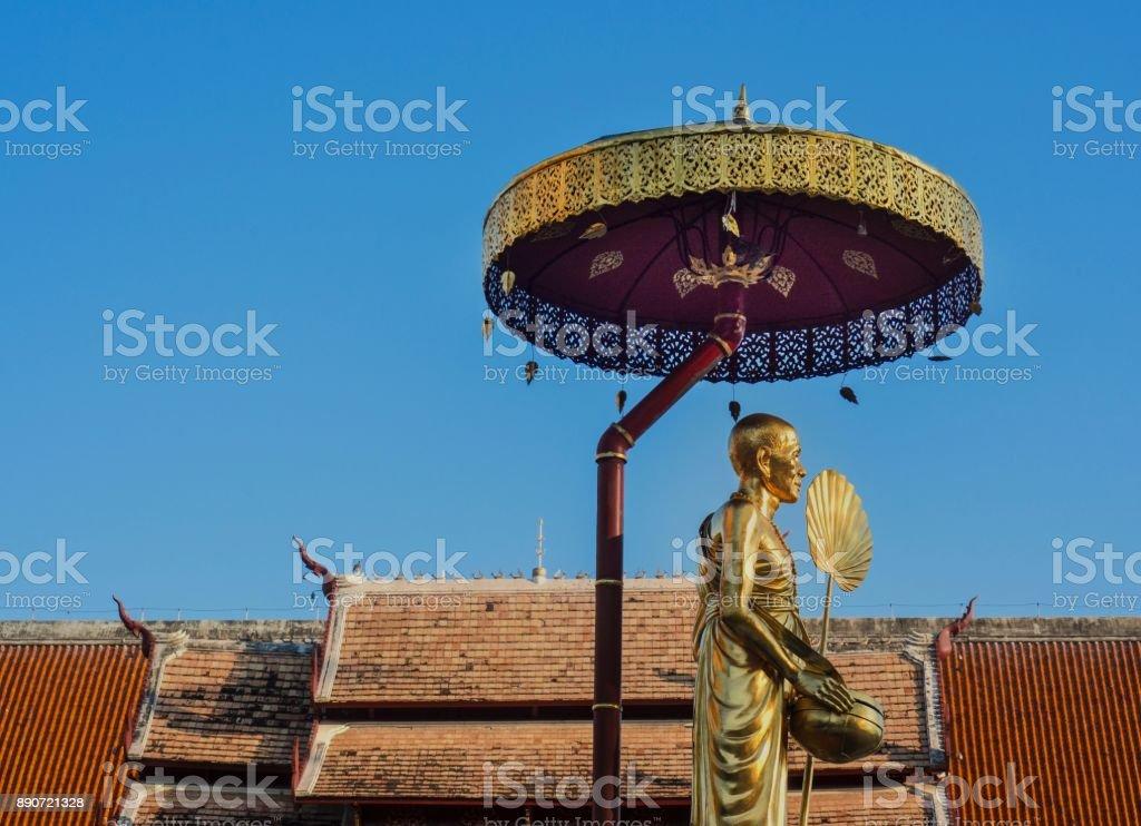 Golden Monk Statue At Wat Phra Singh Temple stock photo