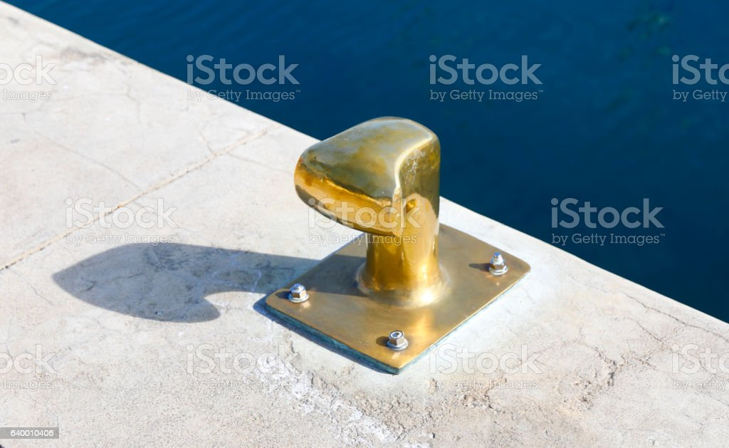 Golden mooring post at the Canary Islands stock photo